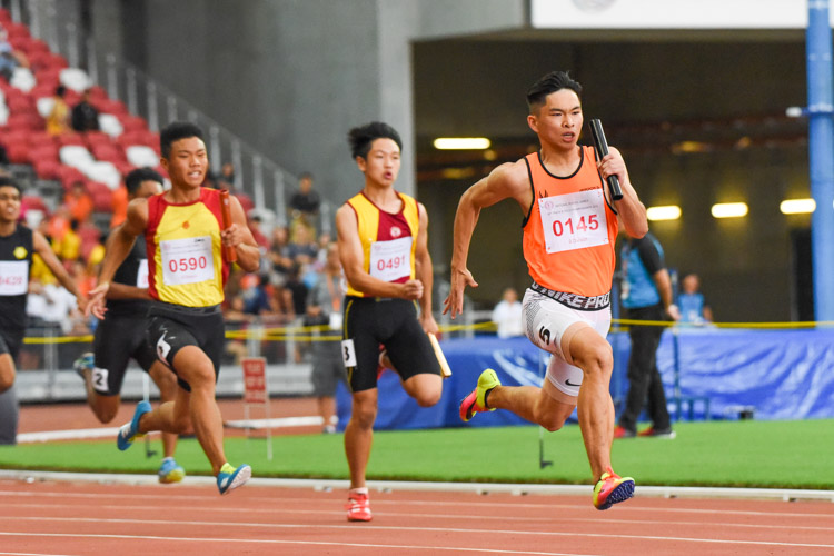SSP's Nicholas Teo (#145) anchoring his team to the B Division boys' 4x400m relay gold, as HCI's Zeen Chia (#590) and VS's Kieren Lee (#491) give chase. HCI and VS finished in third and fourth respectively. (Photo 1 © Iman Hashim/Red Sports)