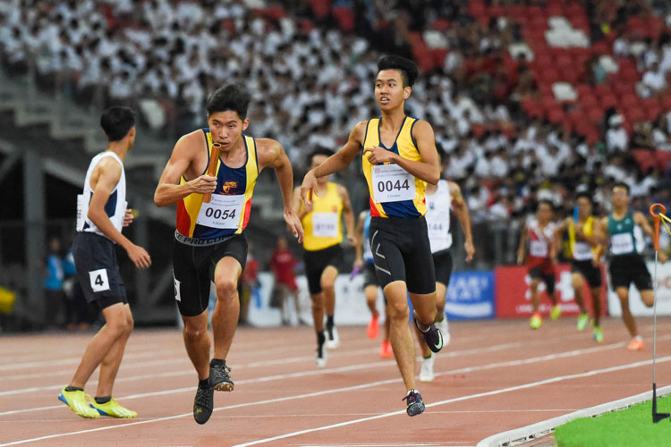 ACS(I)'s James Ethan Ang (#54) starts his anchor leg in the A Division boys' 4x400m relay. His team finished in third place with a time of 3:33.32. (Photo 1 © Iman Hashim/Red Sports)