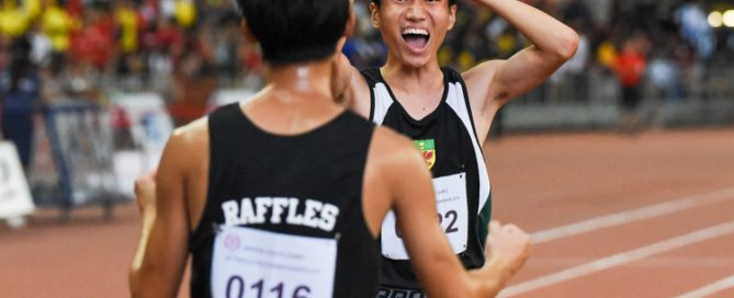 Marcus Tan (#122) celebrating with teammate Samuel Lee (#116) after the race, in disbelief that he has just clinched the A Division boys' 4x400m relay gold for RI. (Photo 1 © Iman Hashim/Red Sports)