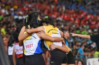 The NYGH team celebrate their win in the B Division girls' 4x400m relay. (Photo 1 © Iman Hashim/Red Sports)