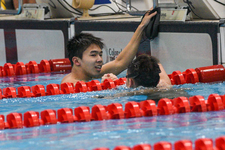 Jonathan Tan of ACS(I) and Glen Lim of RI congratulate each other after the A Division boys' 200m Medley Relay final. (Photo 1 © Iman Hashim/Red Sports)