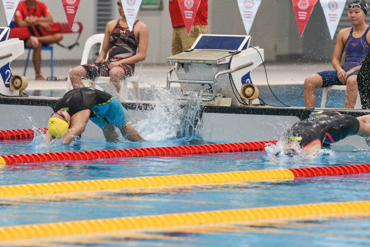 ACJC's Chloe Cheong (yellow cap) starts off her backstroke leg in the A Division girls' 200m Medley Relay final. Her team earned the bronze. (Photo 1 © Iman Hashim/Red Sports)