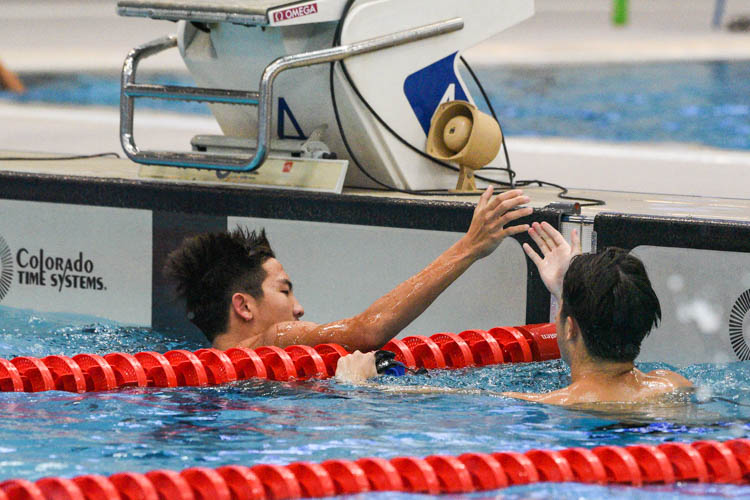 Timothy Lim of ACS(I) high-fives his competitor after the B Division boys' 200m Medley Relay final.