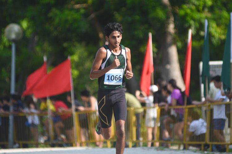 RI's Armand Mohan (#1066), the track 1500m silver medalist, finished fourth in the Boys' A Division cross country race with a time of 16:43.4. (Photo 1 © Iman Hashim/Red Sports)