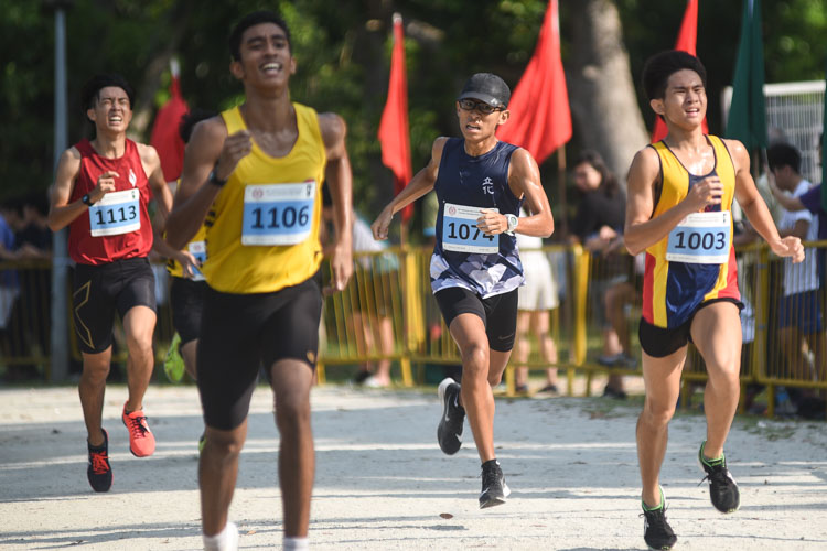 ACJC's Ong Ee Howe (#1003) finished 16th while River Valley High's Lin Jing Hao (#1074) finished 17th in the Boys' A Division cross country race with times of 17:22.5 and 17:23.1 respectively. (Photo 1 © Iman Hashim/Red Sports)