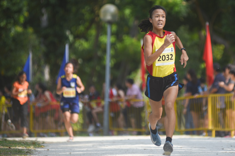 HCI's Clarice Lau (#2032), the track 2000m steeplechase champion, finished second in the Girls' A Division cross country race with a time of 16:02.8. (Photo 1 © Iman Hashim/Red Sports)