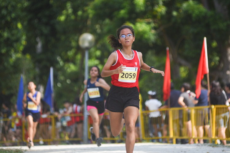 NJC's Ng Yu Ching (#2059) finished seventh in the Girls' A Division cross country race with a time of 16:45.9. (Photo 1 © Iman Hashim/Red Sports)