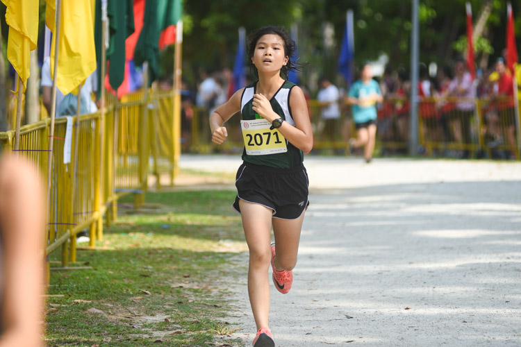 RI's Patrice Tan (#2071) finished 18th in the Girls' A Division cross country race with a time of 17:35.8. (Photo 1 © Iman Hashim/Red Sports)