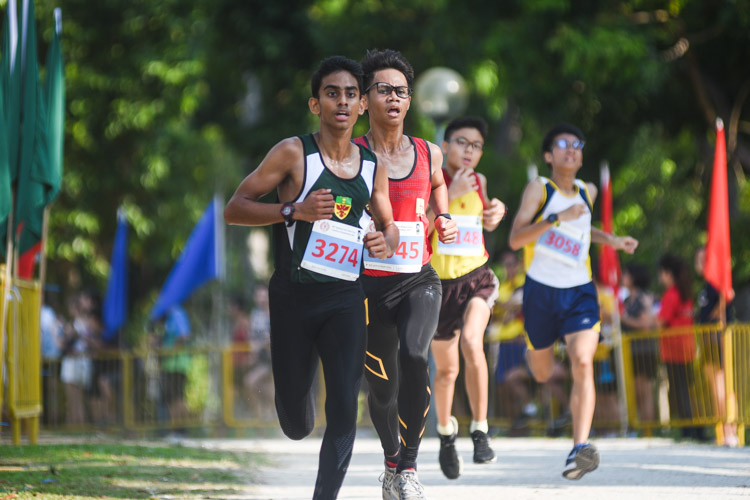 RI's Hiren Koban (#3274) finished 13th while Bukit Batok Secondary's Letrodo Rojean Macabenta (in red) placed 14th in the Boys' B Division cross country race with times of 17:54.4 and 17:54.8 respectively. (Photo 1 © Iman Hashim/Red Sports)