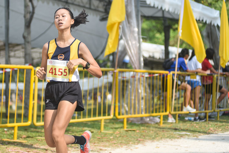 Erica Chan finished 16th in the Girls' B Division cross country race with a time of 17:03.1 to help MGS clinch the team title. (Photo 1 © Iman Hashim/Red Sports)