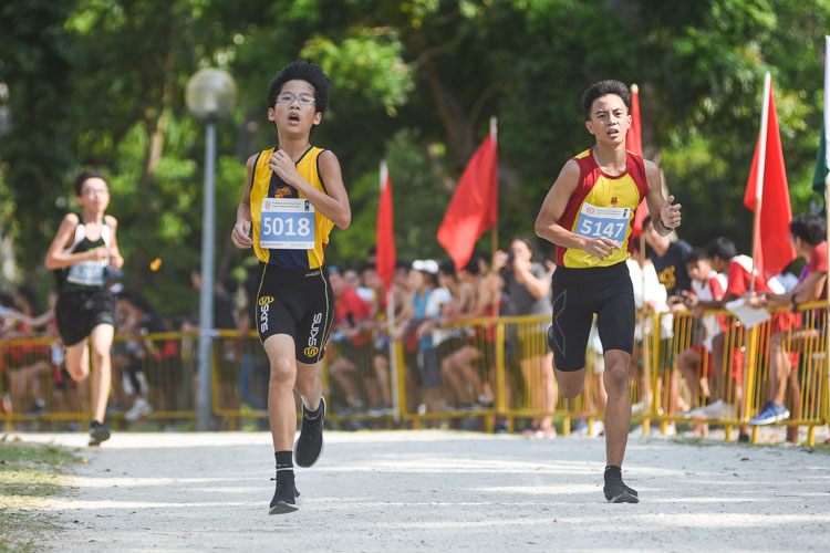 ACS(I)'s Ryan Wong (#5018) finished fifth in the Boys' C Division cross country race with a time of 14:03.1. (Photo 1 © Iman Hashim/Red Sports)