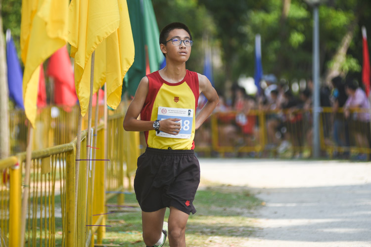 HCI's Yang Heran finished 10th in the Boys' C Division cross country race with a time of 14:18.7. (Photo 1 © Iman Hashim/Red Sports)