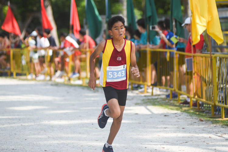 Victoria School's Ezra Satchy finished 11th in the Boys' C Division cross country race with a time of 14:27.8. (Photo 1 © Iman Hashim/Red Sports)