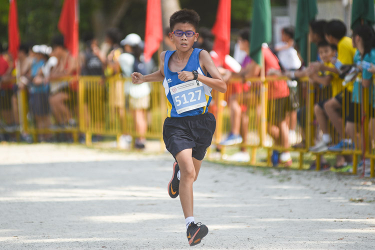 Guangyang Secondary's Jadon Loo finished 23rd in the Boys' C Division cross country race with a time of 15:14.5. (Photo 1 © Iman Hashim/Red Sports)