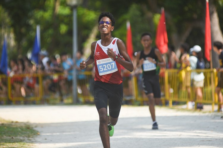 NJC's Thaarmin Thana Rajan (#5207) finished 24th in the Boys' C Division cross country race with a time of 15:17.7. (Photo 1 © Iman Hashim/Red Sports)