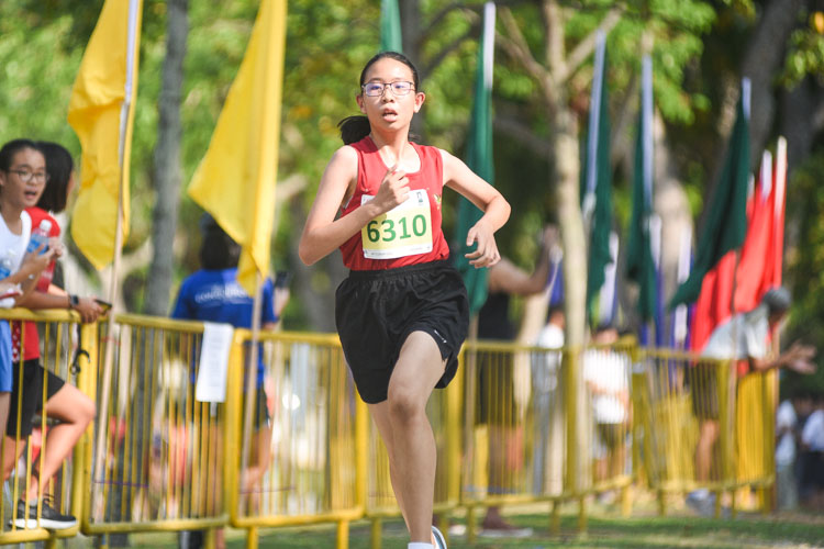 Unity Secondary's Lim Qian Hui (#6310) finished sixth in the Girls' C Division cross country race with a time of 17:18.0. (Photo 1 © Iman Hashim/Red Sports)