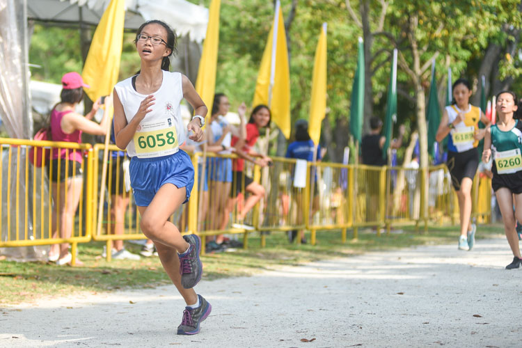CHIJ St. Nicholas Girls' Kristel Koh (#6058) finished ninth in the Girls' C Division cross country race with a time of 17:24.2. (Photo 1 © Iman Hashim/Red Sports)