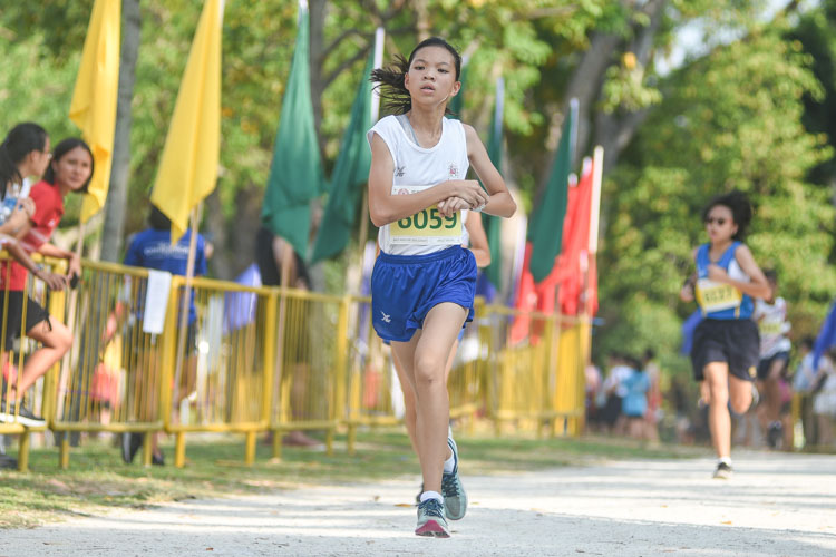 CHIJ St. Nicholas Girls' Janelle Tang (#6059) finished 21st in the Girls' C Division cross country race with a time of 17:57.2. (Photo 1 © Iman Hashim/Red Sports)