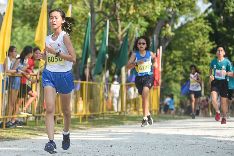 CHIJ St. Nicholas Girls' Chloe Tan (#6056) finished 22nd in the Girls' C Division cross country race with a time of 17:58.7. (Photo 1 © Iman Hashim/Red Sports)