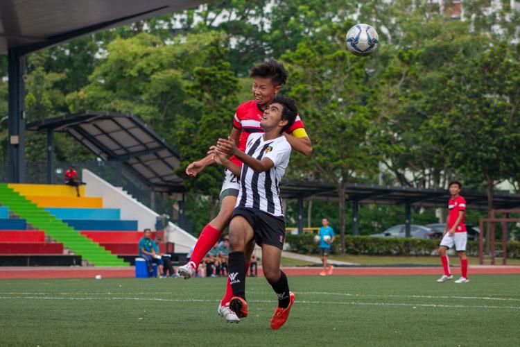 Jonathan Chen (NJC #26) beats Emir Haady (RI #10) to the ball. (Photo 1 © REDintern Jordan Lim)