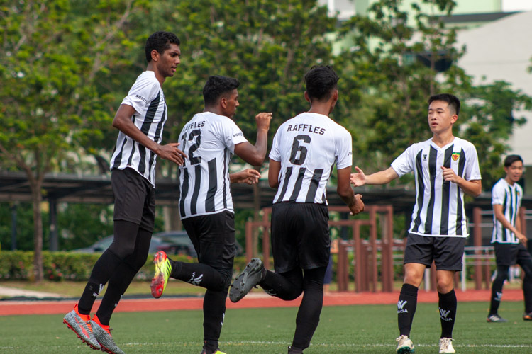 Raffles players celebrating after Haaroon converts a penalty, making it 2-0. (Photo 10 © REDintern Jordan Lim)