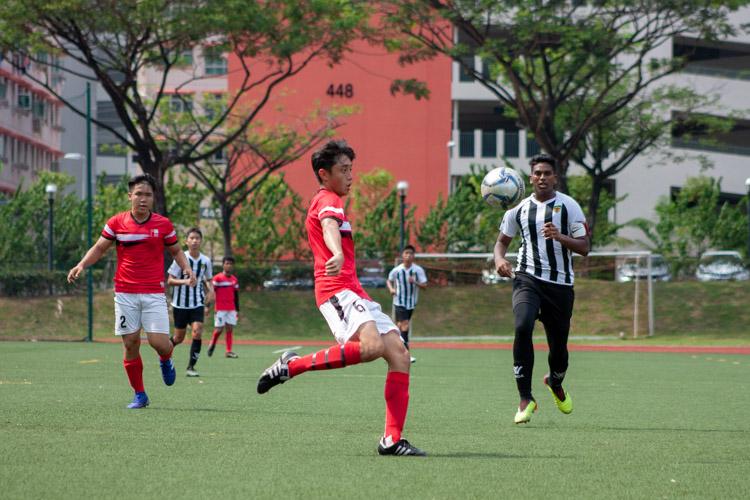 Nicholas Yap (NJC #6) volleys the ball to open space. (Photo 3 © REDintern Jordan Lim)