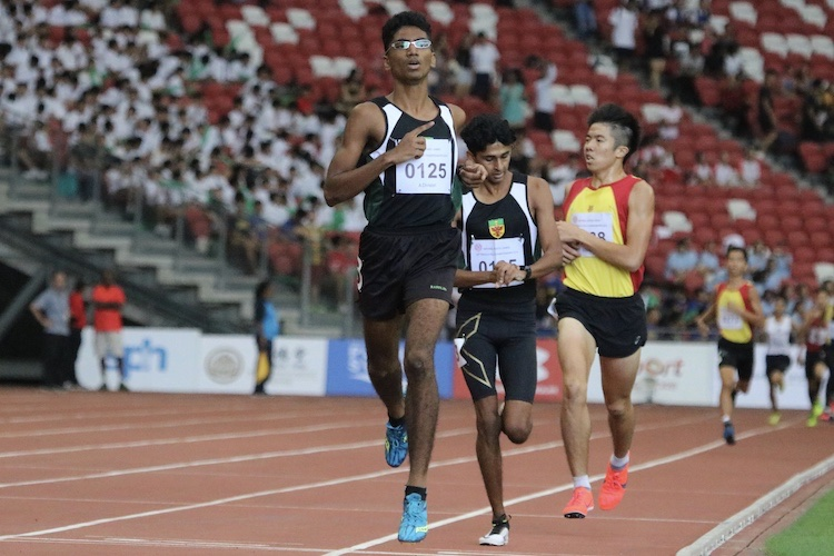 Nedunchezian Selvageethan of Raffles Institution takes home the gold for the A division 1500m race.(Photo 2 © REDintern Julianna Jothi)