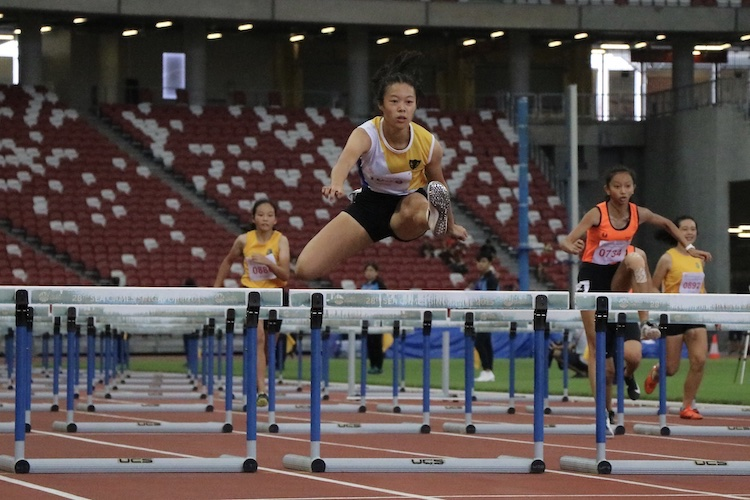 Elizabeth-Ann Tan came in first place with a timing of 14.59s and set a new record for the B division girls 100m hurdles.