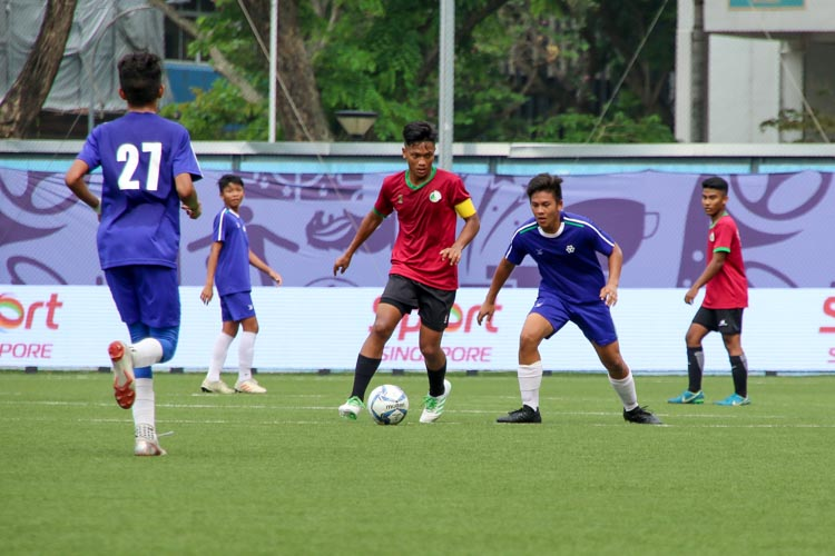 JVSS's Captain, Nur Fazli (#4), dribbles the ball in midfield. (Photo 3 © Clara Lau/REDintern)