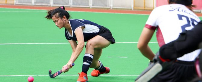 Germaine Koh (SAJC #14) attempts a shot at goal. (Photo 2 © Clara Lau/REDintern)