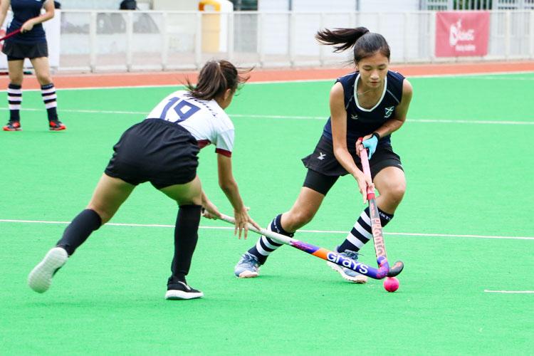Chew Xin Yun (SAJC #9) dribbles the ball through midfield. (Photo 4 © Clara Lau/REDintern)