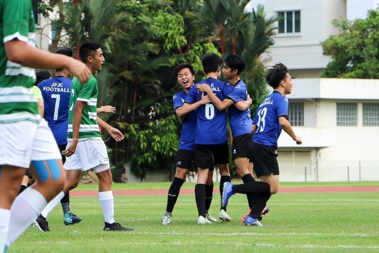 JPJC players celebrating scoring the opening goal of the game. (Photo 1 © Clara Lau/REDintern)