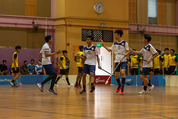 TMJC players exchanging hi-fives as they made a late comeback against VJC. (Photo 8 © REDintern Jordan Lim)