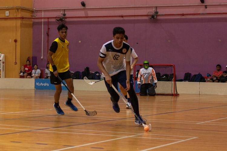 Muhammad Ammar (TMJC #62) dribbles the ball towards the goal. (Photo 9 © REDintern Jordan Lim)