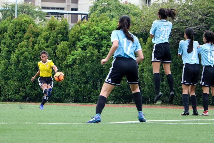 Nur Darwisyah (VJC #12) takes a shot at goal from a free-kick. (Photo 1 © Clara Lau/REDintern)