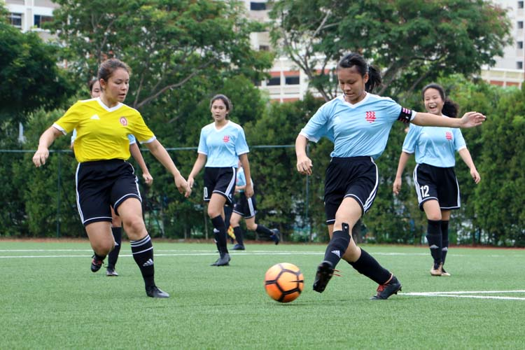 HCI Captain, Carissa Lee (#4), clears the ball. (Photo 2 © Clara Lau/REDintern)