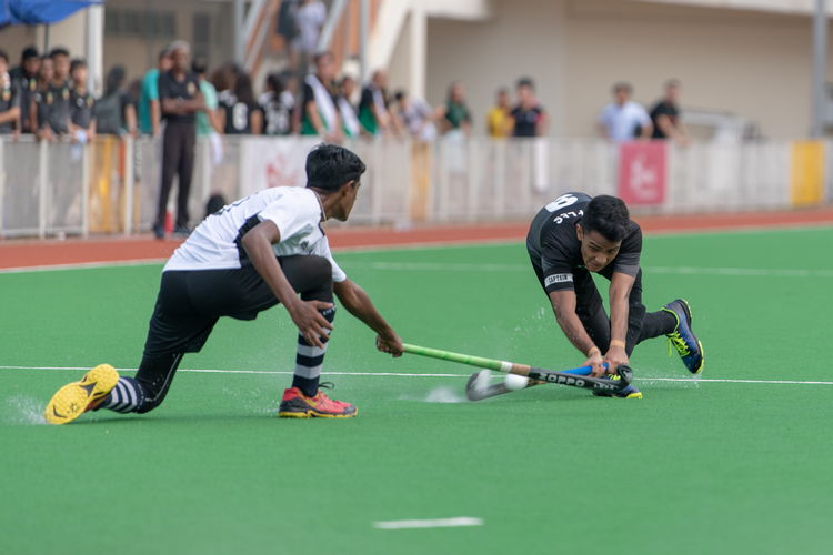 Thaarshen (SA #10) reaches out to stop Raffles captian Raziq Noor's (RI #9) pass.