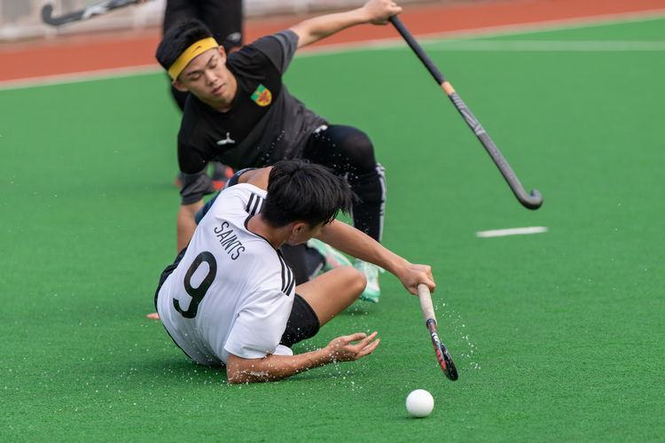 Ray Au (SA #9) trips over Ethan Tan's (RI #7) stick and tumbles to the ground.