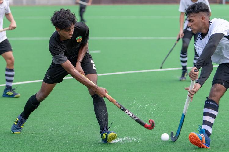 Sailesh Kumar (SA #5) blocks a shot by Akash Chandra (RI #82).