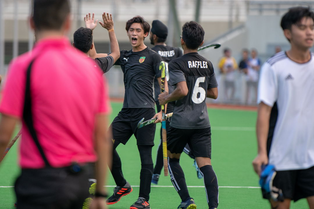 Alton Chua (RI #10) celebrating after a clean goal.