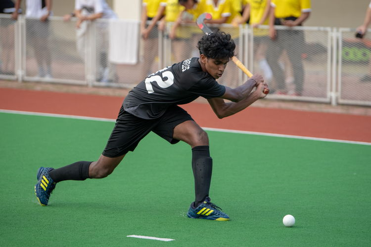 Akash Chandra (RI #82) swings for the ball.