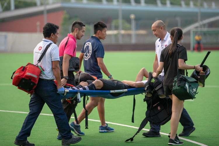 Saints' primary keeper, Andrew Chua (#16), had to be carried off the field on a stretcher after injuring his back saving a ball.