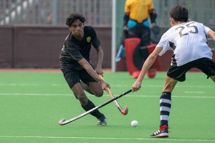 Akash Chandra (RI #82) runs into a ready-and-waiting Joven Teo (SA #25).