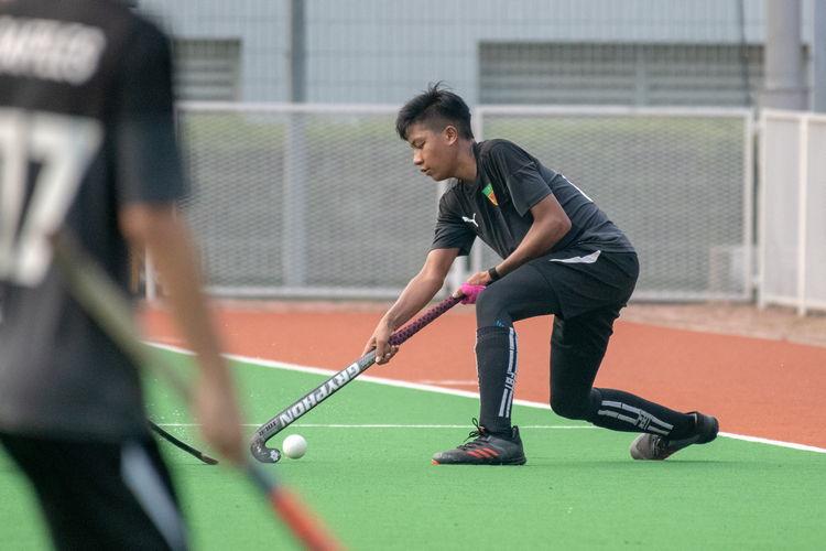 Haikel Yasin (RI #66) controls the ball.
