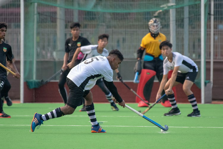 Sailesh Kumar (SA #5) takes a shot at the Raffles goal.