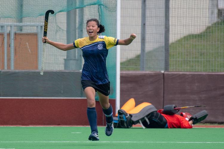 Valerie Koh elatedly celebrates her winning penalty goal against VJC.