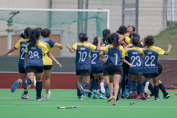The EJC girls celebrate after captain Valerie Koh's (#17) winning penalty goal.
