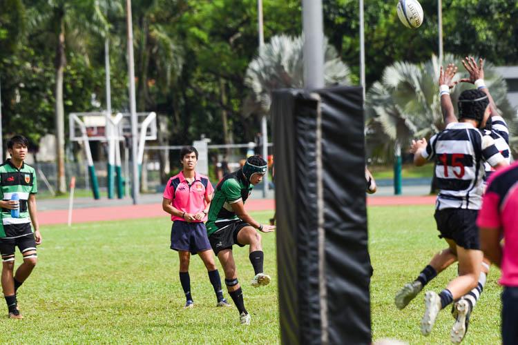 RI scrum-half Bervyn Wong (#10) kicks the conversion. (Photo 1 © Iman Hashim/Red Sports)