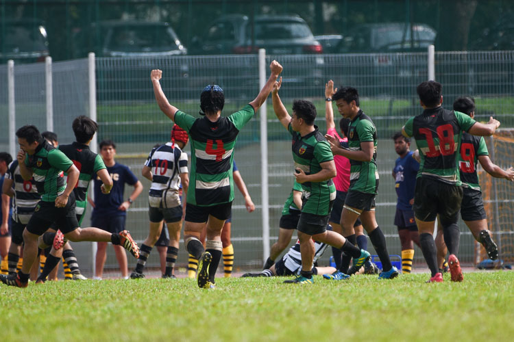 RI players celebrate their second-half try that put them 17-5 up. (Photo 1 © Iman Hashim/Red Sports)