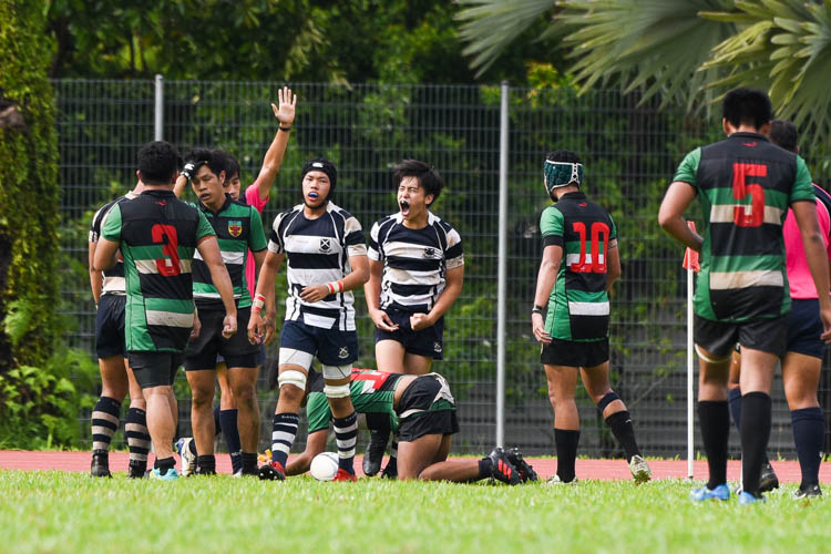 Ryan Ham (SAJC #25) roars in celebration after scoring a try to give Saints a glimmer of hope for a comeback. (Photo 1 © Iman Hashim/Red Sports)
